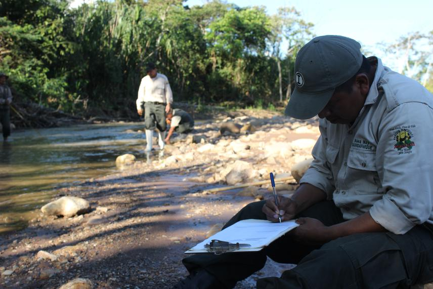 Madidi park guard Alex Nae recording water levels.