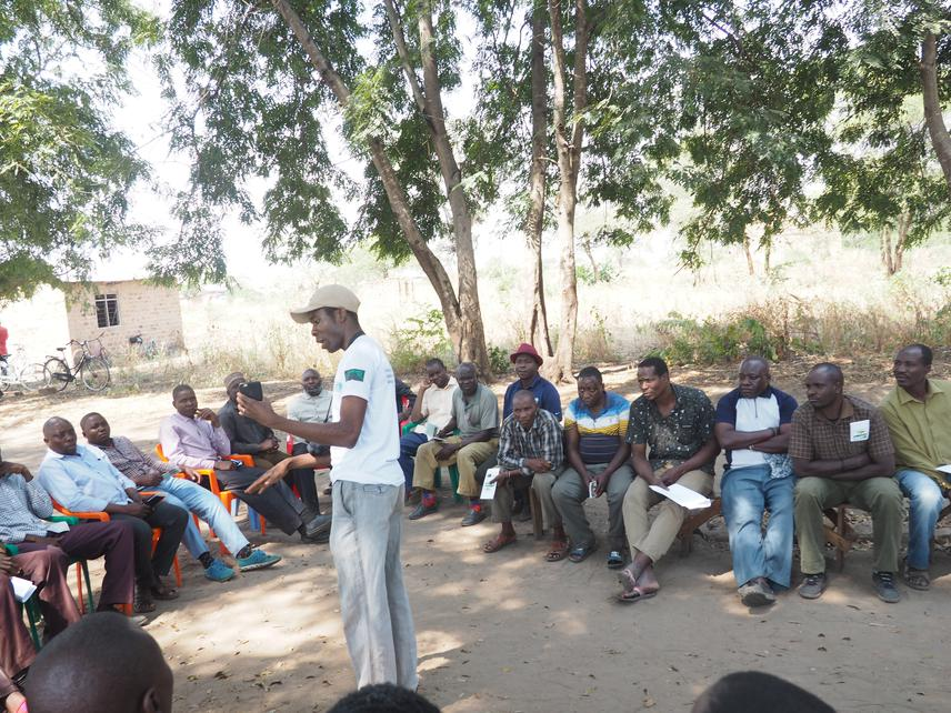 BJonathan Kwiyega elaborating some issues during Mwamatiga village(a in south of Mlele Game Reserve)  by-laws approval. © Neema Mwaja