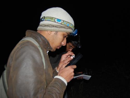 A participant handling a heterodyne bat detector.