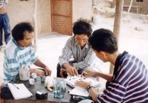 Diep Dinh Phong (right), ornithologist, interviewing local community.
