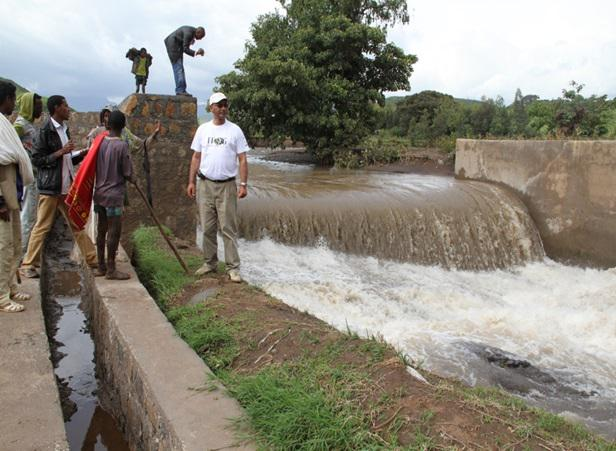 The principal investigator and a graduate student, Gizachew Teshome, at a newly constructed small dam and diversion canal on Shini River.